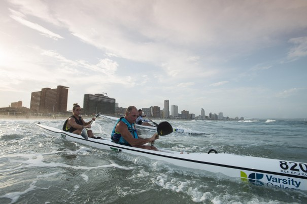 Father/daughter crew of Richard and Collette Saunt make their way out through the surf at the start of the McCarthy Toyota Kingsmead Durban Surfski Challenge, race three of the 2014 Varsity College Marine Surfski Series.