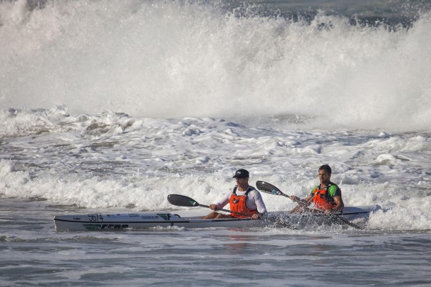 Fenn Kayaks/Mocké Paddling Gear's Dawid (left) and Jasper Mocké (right) charge through the surf at Amanzimtoti to win Sunday's doubles race of the FNB Mazars Durban Downwind, which doubles as the 2014 SA S1 Surfski Championships.  (Photo: Jon Ivins/Gameplan Media)