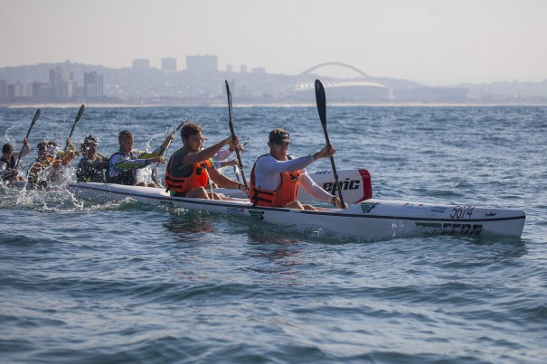 Fenn Kayaks/Mocké Paddling Gear's Dawid and Jasper Mocké lead out A batch at the start of Sunday's doubles race of the FNB Mazars Durban Downwind, which doubles as the 2014 SA S1 Surfski Championships. (Photo: Jon Ivins/Gameplan Media)